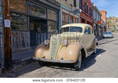 December 9, 2015 Bisbee Arizona USA: vintage collector's car parked in the front of victorian-style bulidings Bisbee earned the title of Best Historic Small Town in several magazines