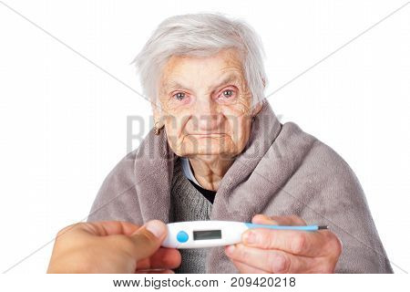 Elderly female with contagious influenza holding medical thermometer with caregiver