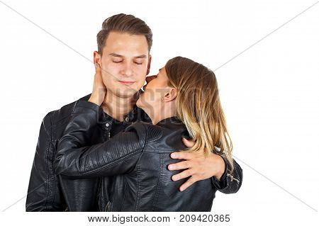 Sensual young woman kissing his boyfriend's neck on isolated background