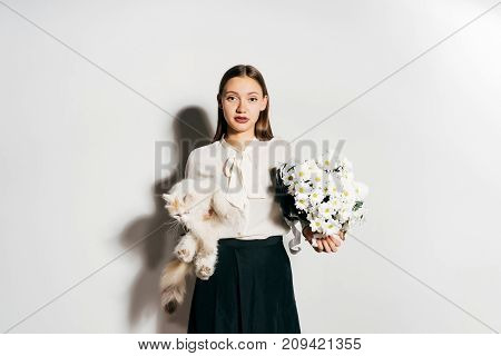 a young girl looks upset because she is allergic to cats and flowers