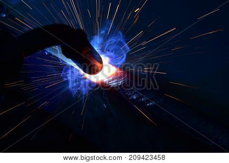 Metal Welding with sparks and smoke metal welding