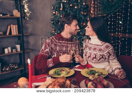Side Profile View Of Festive Partners With Stemware Sitting At X Mas Fest, In Knitted Cute Tradition