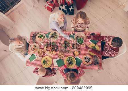 Bon Appetite! Christmastime With Love And Care. High Angle View Of Six Gathered Relatives, Setted Fe