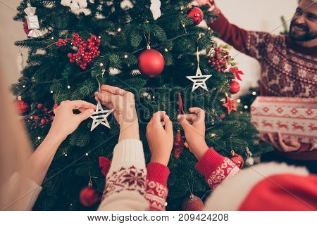 Closeup Shot Of Relatives At Home In Knitted Traditional Costumes, Ready To Celebrate X Mas Eve. Hap