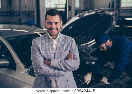 Close Up Portrait Of Excited Attractive Owner Of A Car, Which Gets Appraising Of Damage By Bearded E