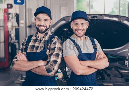 Attractive Cheerful Experts At Work Shop, Standing In Special Blue Safety Outfit Uniform, Checkered