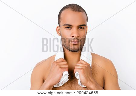 Confident Harsh Young Mulatto Nude Man Is Standing On The Pure White Background, With Towel Around H