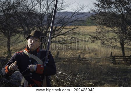 VALLEY FORGE, PENNSYLVANIA - DECEMBER 27, 2014 - Continental Army soldier reenactor at Valley Forge National Historical Park gives an historic weapons demonstration