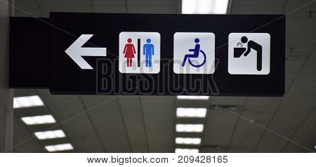 Toilets disabled symbol and drinking water signs in departure hall