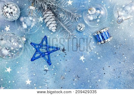 Christmas Holiday Decorations On Blue Glittering Background