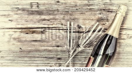 Champagne. Champagne Bottle And Two Empty Glasses On A Wooden Background. Valentine's Day. Birthday.