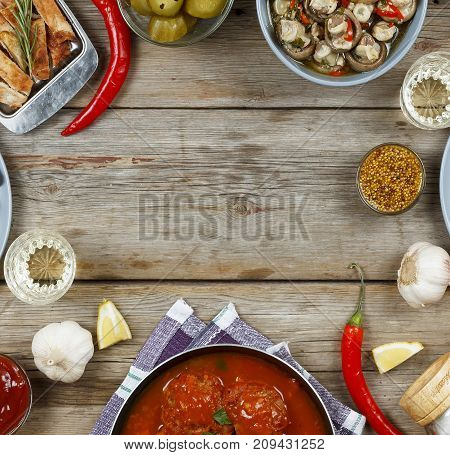 Dining Table With A Variety Of Meals And Snacks. Meatballs, Baked Potato Wedges, Meat, Mushrooms, Ke