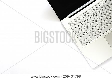 Laptop with black screen on white background.