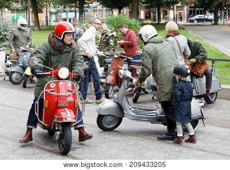 STOCKHOLM SWEDEN - SEPT 02 2017:Many vespa scooters and mods dressed in parka jackets in the city at the Mods vs Rockers event at the Saint Eriks bridge Stockholm Sweden September 02 2017