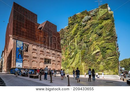 Madrid, Spain - October 14, 2017: Outdoors view of CaixaForum Madrid is a museum and cultural center in Paseo del Prado sponsored by La Caixa Bank. It was constructed by Herzog and de Meuron.