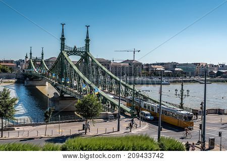 Budapest, Hungary - August 14, 2017:  Liberty Bridge in Budapest. High angle view with tramway crossing a sunny day of summer