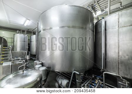 Industrial equipment, a group of metal tanks at a liquor plant.