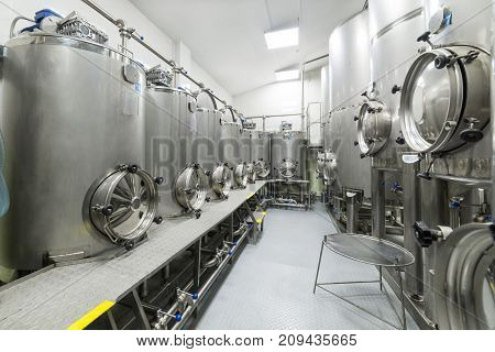 Shop with large metal tanks, modern production of beverages. Food industry.