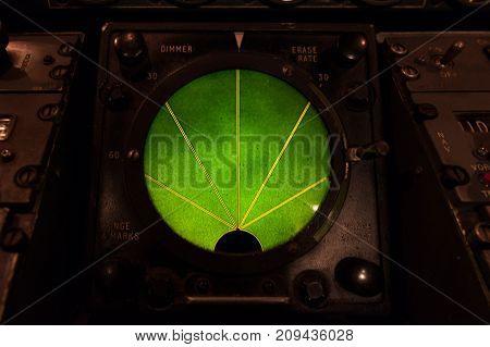 Closeup of green glowing aircraft radar gauge display