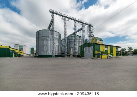 Large steel silos, storage and processing of wheat and barley grain.