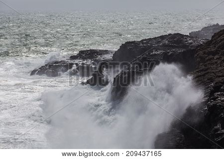 Waves Breaking Hard On Rocks - Extreme Force Of Nature.