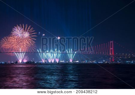 Fireworks over Istanbul Bosphorus during Turkish Republic Day celebrations. 15th July Martyrs Bridge (15 Temmuz Sehitler Koprusu). Istanbul, Turkey.