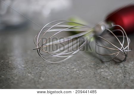 Stainless Steel Whisks for beating to blenders and mixers. Blurred background