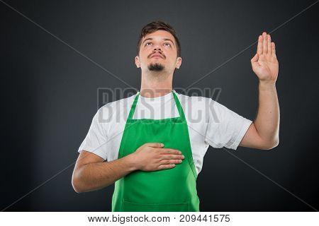 Portrait Of Attractive Supermarket Employer Making Oath Gesture