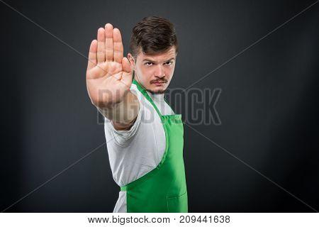 Portrait Of Attractive Supermarket Employer Showing Stop Gesture