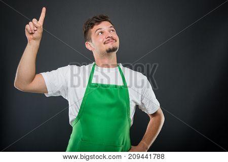 Supermarket Employer Posing Like Having Good Idea