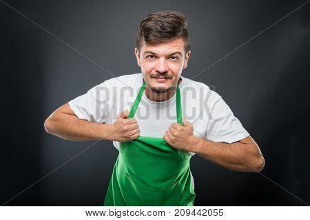 Portrait Supermarket Employer Holding His Apron
