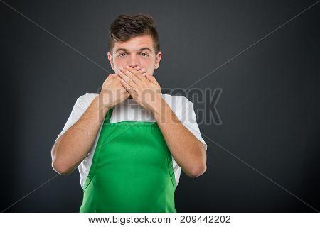 Portrait Of Supermarket Employer Gesturing Mute Monkey