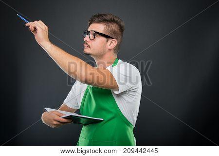 Portrait Of Supermarket Employer Holding Pen And Agenda
