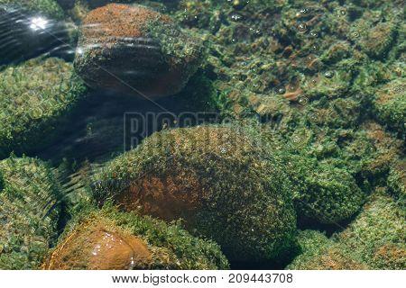 hot spring detail of rocks near volcano