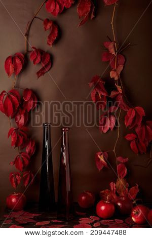 Autumn monochrome still-life in red and burgundy shades. Selective focus.