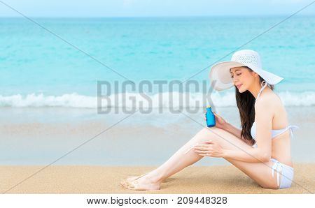 Girl Sitting On Beach Wearing Bikini Clothing