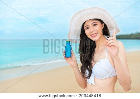 Sexy Female Traveler Using Sun Protection Oil