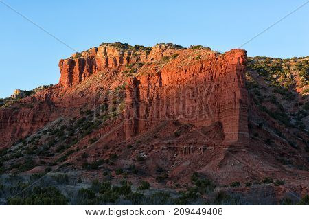 red cliff in the last rays of sunset at Caprock Canyon Texas