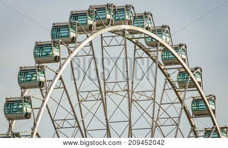Long shot of Ferris Wheel Over white Sky