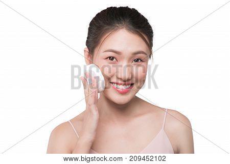 Portrait Of Beautiful Young Asian Model Applying Some Powder Using Powder Puff