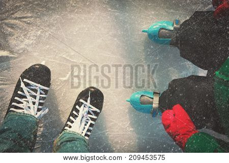 father and child learning to skate in winter, winter sport