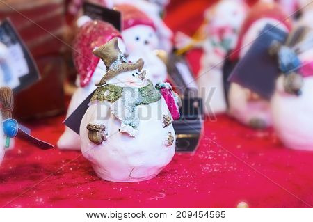 European Christmas market stall with snowman close-up