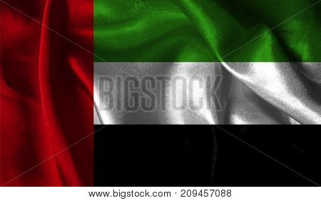Realistic flag of United Arab Emirates on the wavy surface of fabric. This flag can be used in design.