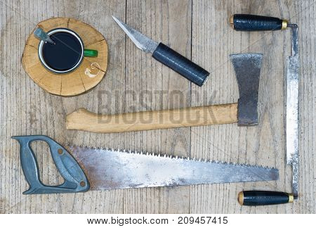 a set of carpentry tools on a wooden table