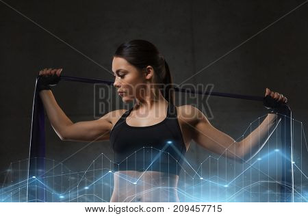 fitness, sport, training, people and lifestyle concept - woman doing exercises with expander in gym