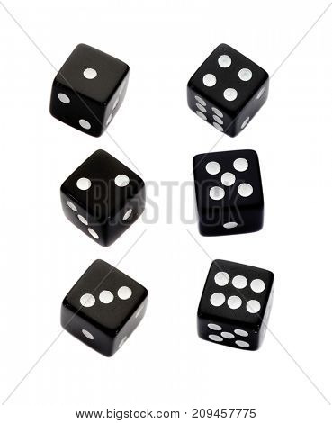 Six black dices with all the numbers isolated on a white background