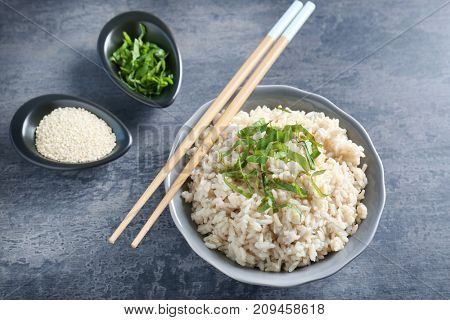 Dish with white rice on table