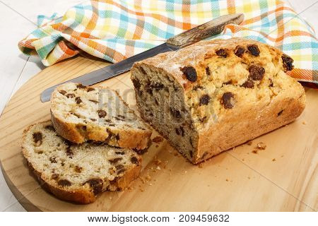 raisin bread cut in to slices on wooden board