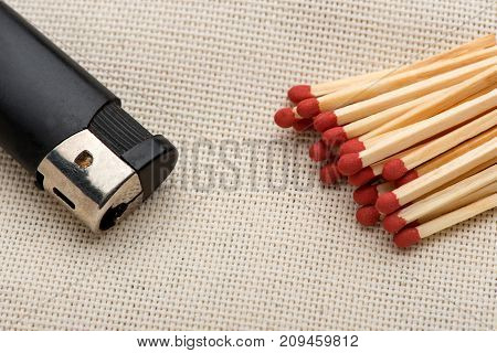 matches and a lighter, sulfur, wooden, matches, lighter