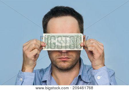 A Man Holds A U.s. 1 One Dollar